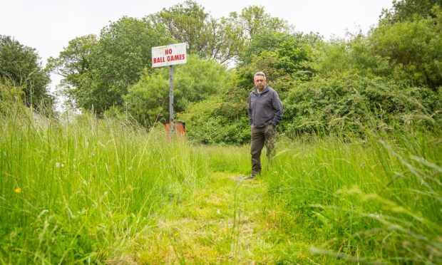 """Councillor Forbes says unkempt greenspaces are making residents' lives """" a misery""""."""