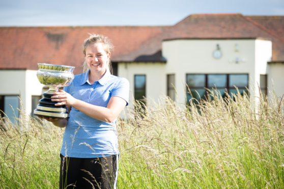 Kimberley Beveridge win the Scottish Women's Championship trophy.
