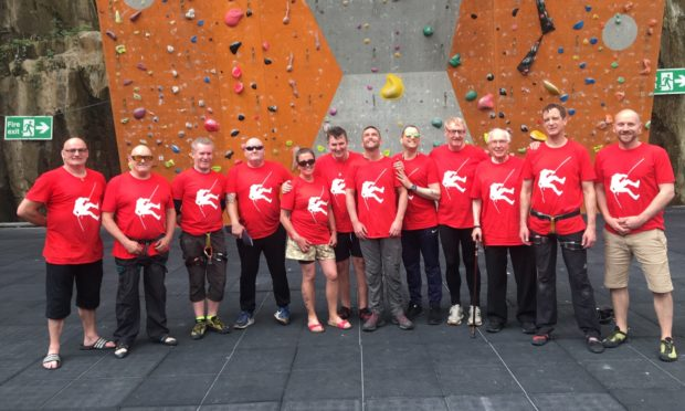 Garry seventh from the left) with the team scaling the heights