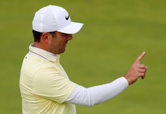 Italy's Francesco Molinari passe on the Open title to Shane Lowry.
