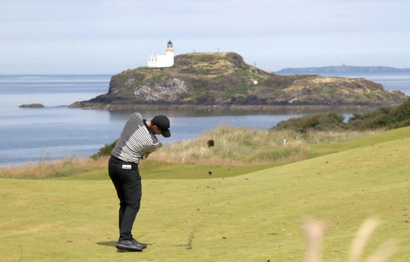Rory McIlroy hits to the the 4th hole at Renaissance in the first round of the Scottish Open yesterday.