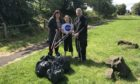 Angus Forbes, Gillian Docherty and her daughter, Hannah, 10, are fed up of seeing drivers leave a mess at Invergowrie.