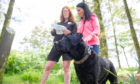 Gayle Ritchie with her dog Toby and AngusAlive countryside ranger Lisa King at Crombie Country Park.