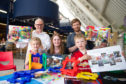 Ged Young and Aidan Williams from Aim Design with Anna Gilruth,6, head of development Rebecca Duncan and Luke Judson, 6.