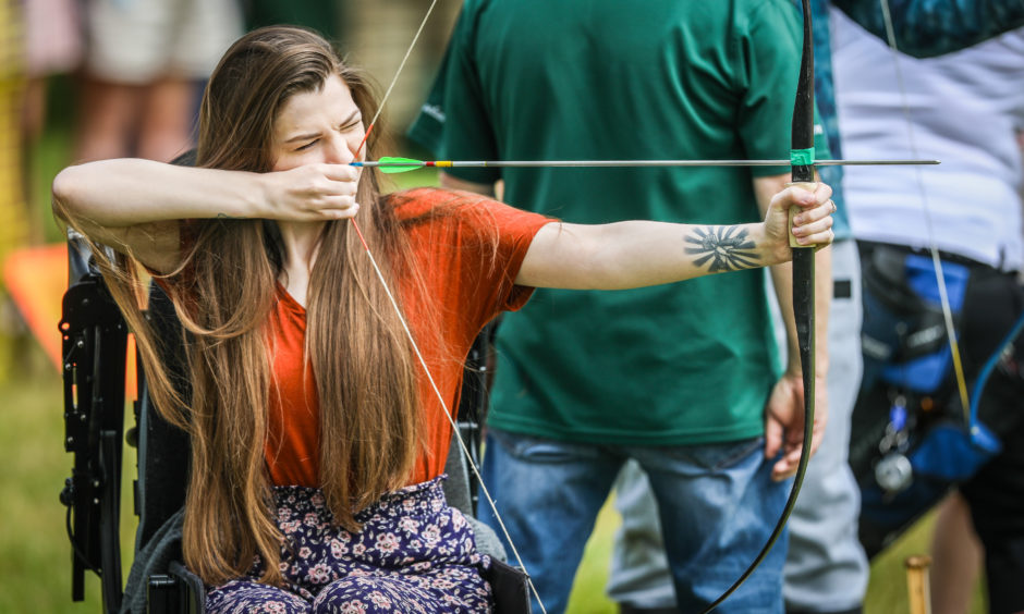 Hollie Morrison trying her hand at archery at the Scottish Game Fair.