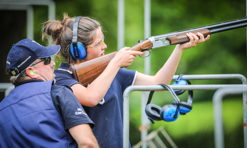 Georgina Sheppard getting shotgun tuition at the Scottish Game Fair at Scone Palace.