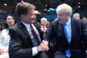 Jeremy Hunt (left) congratulates Boris Johnson at the Queen Elizabeth II Centre in London where he was announced as the new Conservative party leader, and will become the next Prime Minister.