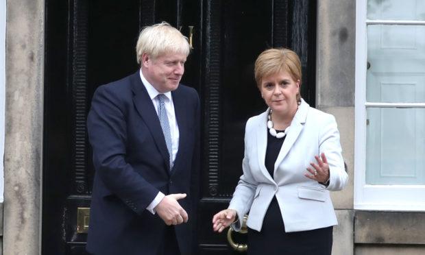 Scotland's First Minister Nicola Sturgeon welcomes Prime Minister Boris Johnson outside Bute House in Edinburgh in July.