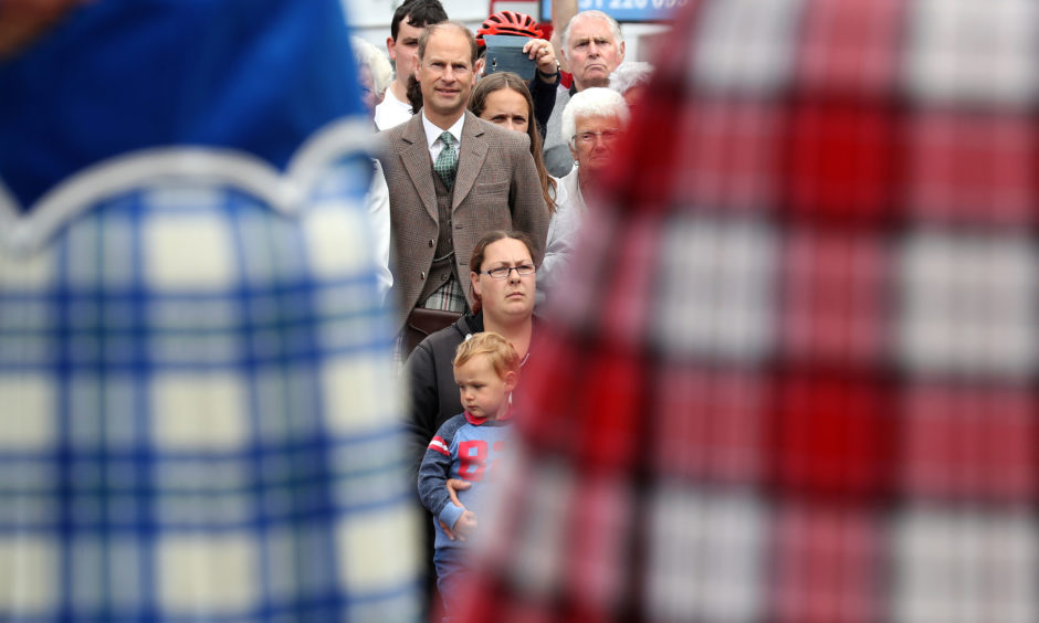 The Earl of Forfar watches a highland dancing performance as they arrive on Castle Street in Forfar.