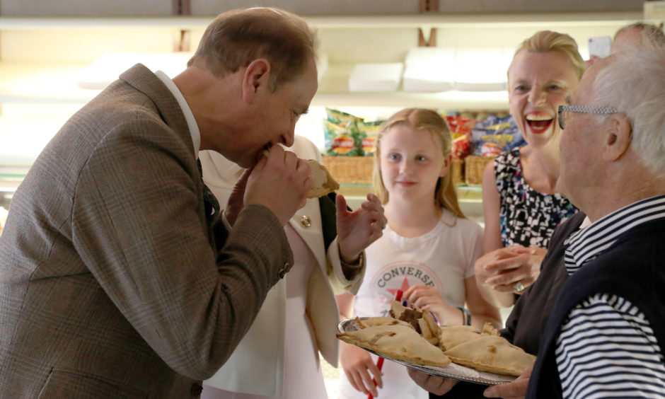 The Earl and Countess of Forfar try a Forfar Bridie whilst visiting Saddler's of Forfar Bakery in Forfar.