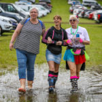 Travel advice issued as Rewind Festival gets off to soggy start