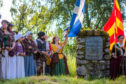 The ceremony at the battlefield memorial cairn commemorating the 330th anniversary of the Battle of Killiecrankie.