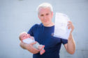 Kevin Coull and his daughter Isla who is angry at a parking ticket given at Ninewells Hospital