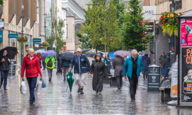Shoppers on a wet Perth High Street.