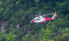 A Coastguard rescue helicopter aids in the rescue at Weem Crags.