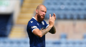 Dundee's Jordon Forster admits it is difficult not to keep eye on what neighbours are doing in Championship