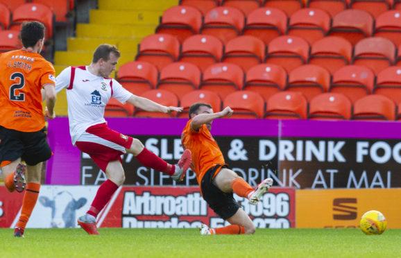 Liam Watt scores against United.