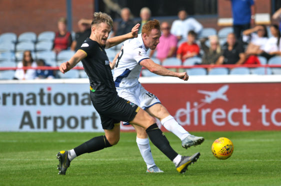 Danny Johnson fires Dundee into last 16.