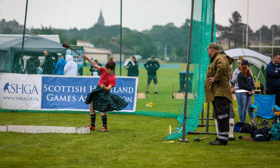 Junior Shot Putt contestants practice their technique.