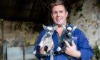 Buffalo Farm owner Steven Mitchell with the newborn Pygmy Goats.