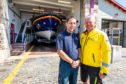 Michael Bruce, coxswain and mechanic, with lifeboat operations manager Roy Giles outside the current Anstruther RNLI station.
