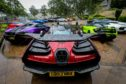 Supercars line up outside Rachel House in Kinross.