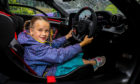 Jackie Davey (7) from Dunbar gets to sample the £1.1 Million pound McLaren Senna.