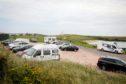Camper vans at Ruby Bay, Elie.