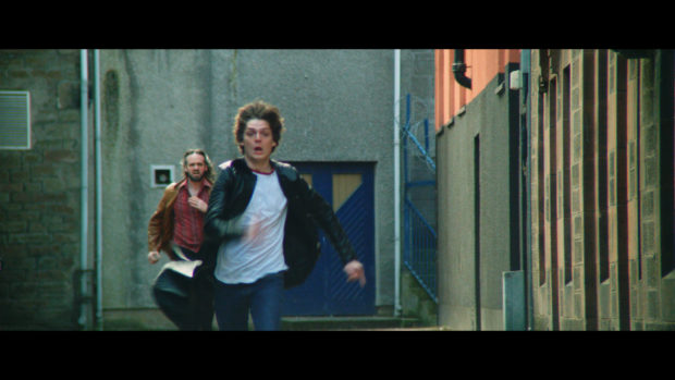 Connor Berry, who plays Dave McLean in Schemers, during a chase scene