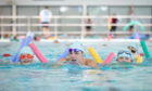 Scottish Swimming Learn to Swim ambassador Duncan Scott takes to the water with local children