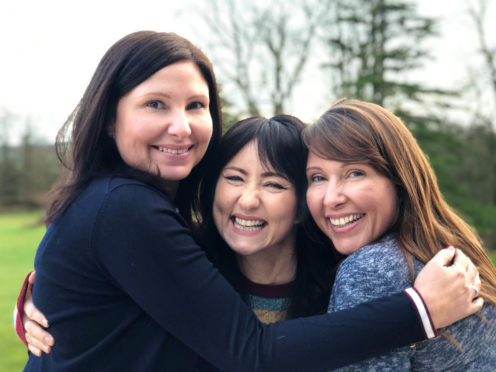 Pictured: Searcher KT Tunstall (centre) with found sisters Siobhan (L) and  Lesley-Anne (R).