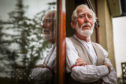 James Watt, 79, was stuck in a lift in Dundee for more than an hour.