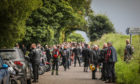 Motorcyclists from the convoy pay their respects at Kinnordy Loch.