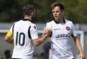Lawrence Shankland celebrates his goal with Nicky Clark.