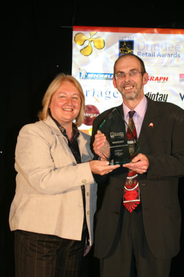 Alastair Brodie of Groucho's is presented with the Independent Trader of the Year awardat the 2008 Retail Awards 2008.