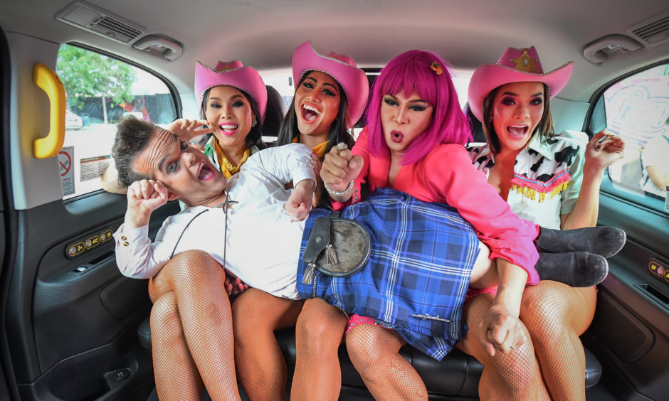 The cast of the Lady Boys of Bangkok squeeze into a taxi during a fundraising event for Edinburgh taxi drivers children's charities. The Lady Boys of Bangkok have returned to the Fringe for a 21st season, appearing at the Theatre Big Top at Fountainbridge from August 2nd - 26th.