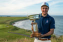 New champion George Burns with the Scottish Amateur trophy.