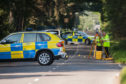 Investigators at the scene of a fatal crash on the B937 near Giffordtown in Fife.