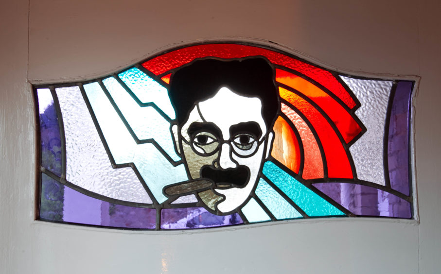 A Groucho's stainglass window in the Brodie household.