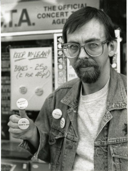 Alastair Brodie, owner of Groucho's Record and Tape Exchange in Marketgait, Dundee, made badges urging Dundee United's then-manager Jim McLean to reconsider his decision to resign. Photo taken in 1988.