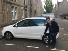 Andrew Cuthbert with his damaged car.