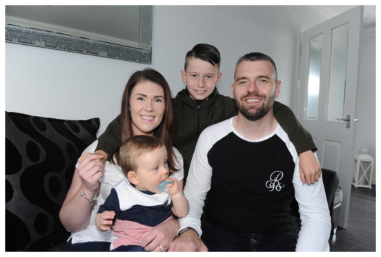 Shelly Friel with her sons Ollie, 10 months, James, 9, and partner James Clark.