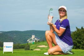 Carly Booth with the Czech Ladies Open trophy.