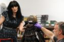 Curator Lesley Lettice and conservator Will Murray work on assembling the striking Japanese samurai suit of armour.