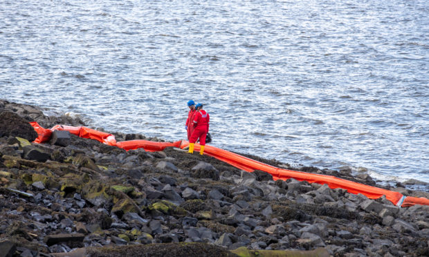 An oil spill is affecting the shore at North Queensferry.