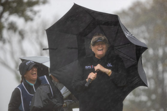 England's Dame Laura Davies continues to smile through the driving wind and rain during day two of the Aberdeen Standard Investments Ladies Scottish Open.