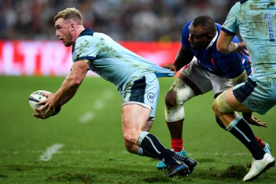 Scotland's full back Stuart Hogg can't get away from France's prop Jefferson Poirot in Saturday's game in Nice.