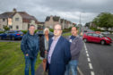 From left  residents , Janne Dick and Norman Dick with Councillor Derek Noble, centre.