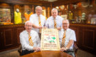 left to right is Ian Wightman, Peter McBride, Tom Cairns and Jim Laing (all Dundee United Business Club) with the poster promoting the event in 1909.