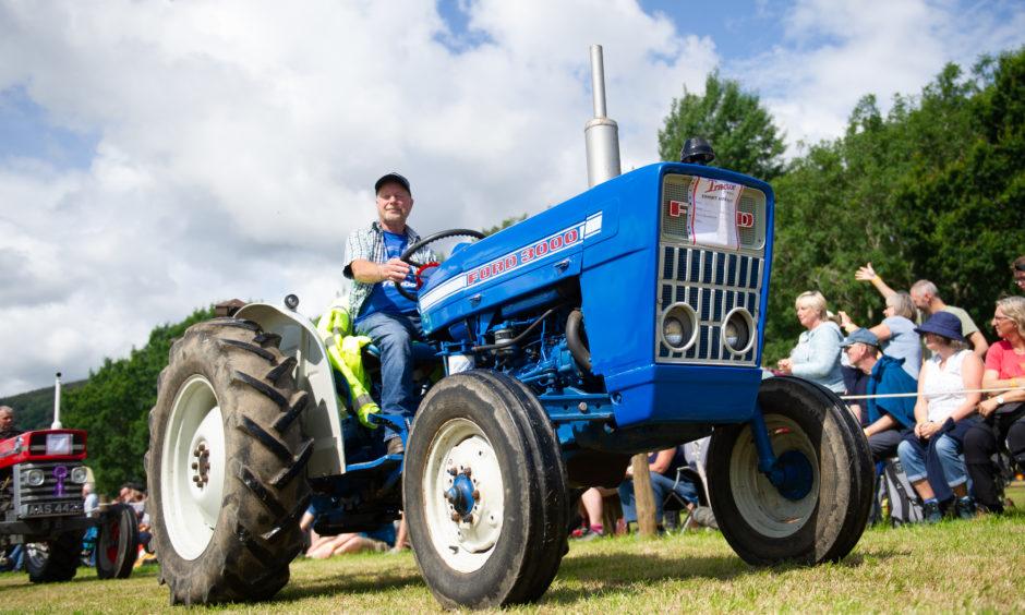 Vintage tractors on parade.
